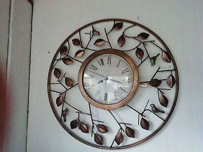 Ornate vintage wall clock, with brass leaves and birds.