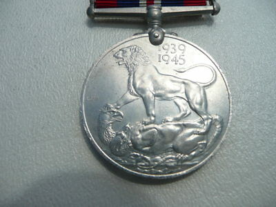 1939 - 1945 English World War Two Medal - King George V with lion and dragon