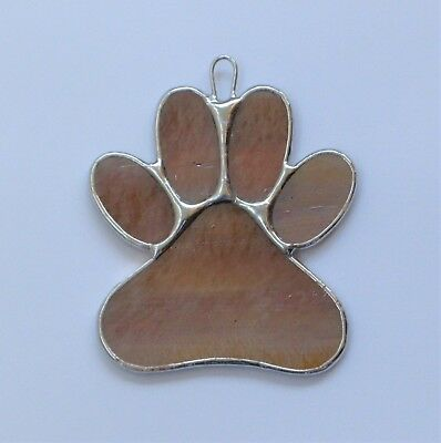Stained Glass Window Ornament (Paw Print) in amber translucent iridescent glass