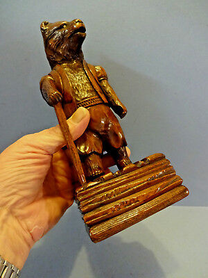 "ANTIQUE CARVED BLACK FOREST BEAR, ""THE HIKER"" MATCH HOLDER, c 1900-1910."