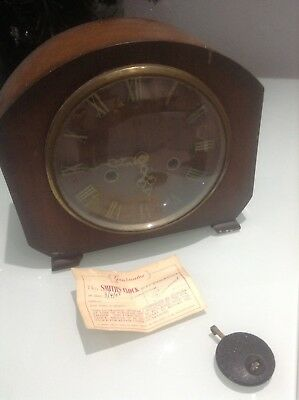 VINTAGE WOODEN SMITHS  MANTLE CLOCK WITH ORIGINAL GUARANTEE CARD sale date 1958