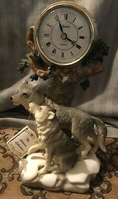 large family of wolves clock,new ,no box ...juliana collection