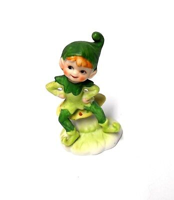 Very Cute Pixie Boy Dressed In Green Sitting On Mushroom Figurine