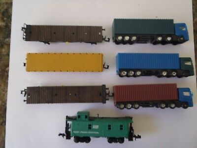Model Trains N Scale 3 Flat Cars With 3 Semi Trailers  1 Caboose