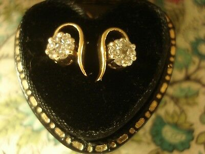 A Beautiful pair Of 18CT Gold: 14 Sparkling Diamonds Set Cluster Design Earrings