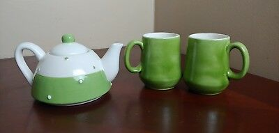 miniature decorative tea set, with tea pot and two small cups