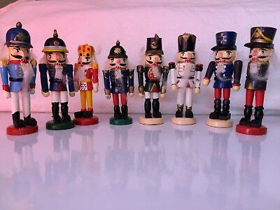 Christmas Decoration Nutcrackers Lot Of 8  nutcracker wooden statues Vintage toy
