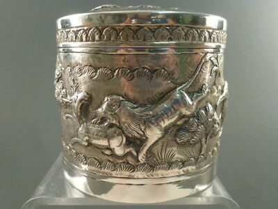 ORNATE INDIAN SILVER TEA CADDY EMBOSSED AND CHASED WITH ANIMALS, incl. elephants