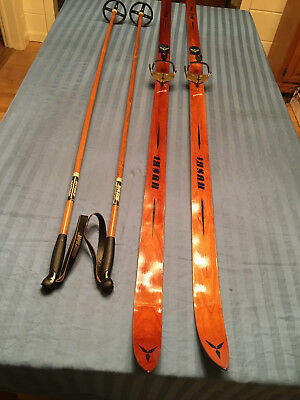 Vintage Cross Country Huski Wood Skis With Brass Bindings And Poles