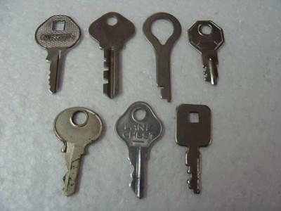 Lot Of 7 Assorted Antique Flat Keys Including Mossberg And Lane Chest