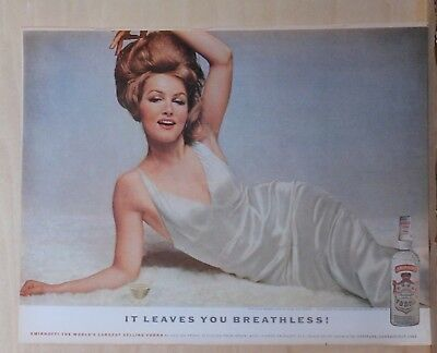 1962 magazine ad for Smirnoff Vodka - Photo of Julie Newmar in seductive pose