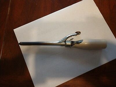 Antique wood stove curling iron