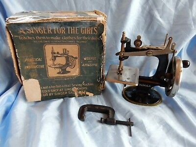 Antique Miniature Hand Sewing Machine for Children made by Singer