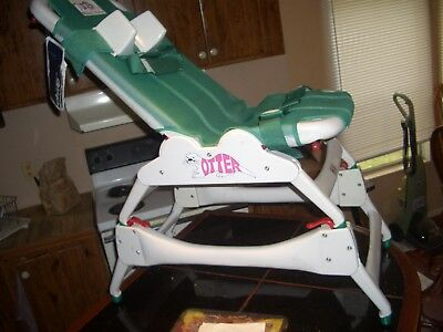 Child's new ? Adjustable green Otter bath chair, includes 8010 stand.