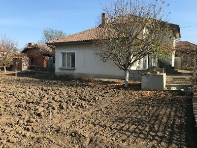 Bulgarian property - two level house with yard FOR SALE