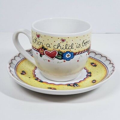 """Mary Engelbreit Tea Cup & Saucer """"When A Child Is Born So Is A Grandmother"""""""