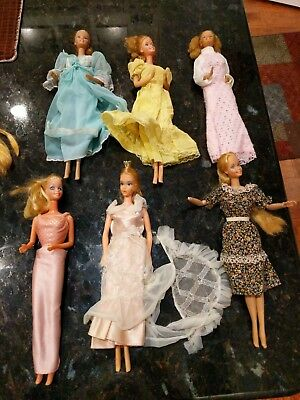 Vintage 1970's Barbie lot of 9 dolls and clothes Pre Owned 80s