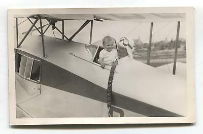 Ayr beach - unknown aviator, toddler, bi-plane - 1933 real photo postcard