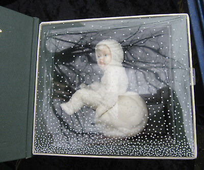 snowbabies dept 56 1986 figure sitting on snowball