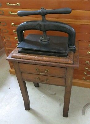A 19th Century Cast Iron Book Press On A Wooden Stand