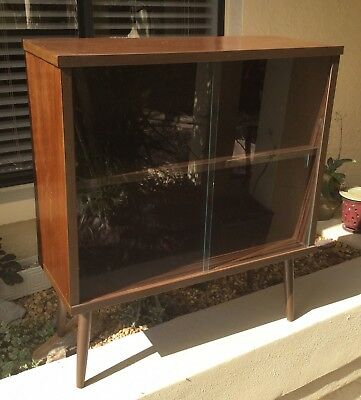 VINTAGE MID CENTURY MODERN FLOATING CONE LEG WALNUT BOOKCASE CURIO w GLASS DOORS