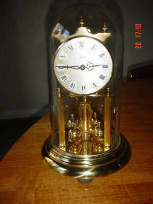Koma  Vintage German 400 day glass dome clock. Brass.Needs new pendulum wire
