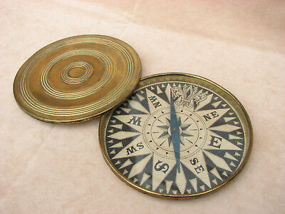 "Antique brass cased 8"" diameter desk top compass."