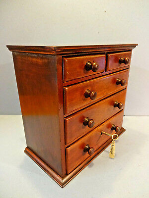 LATE VICTORIAN ANTIQUE CHEST OF MINIATURE SET OF DRAWERS, & KEY. c 1890-1901