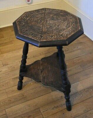 1910  carved wooden tripod 9 sided side end table arts and crafts carved motif