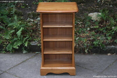An Ercol Light Elm Cd Storage Display Cabinet Shelves Armchair Lamp Phone Table