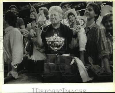 1986 Press Photo Houston Astros' fan holds photos of her favorite Astros player.