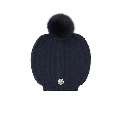 Moncler Woman s Solid Navy Blue Wool Knit Pom Pom Fur Beanie Winter Hat 3029a4a8762