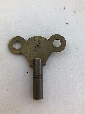 old brass clock key - stamped 5