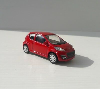 Norev 3 pollici. Peugeot 107 rosso . Nuovo in scatola