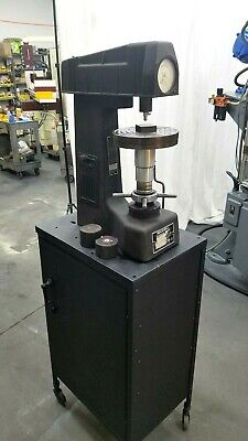Rockwell Hardness Tester with accessories and cabinet