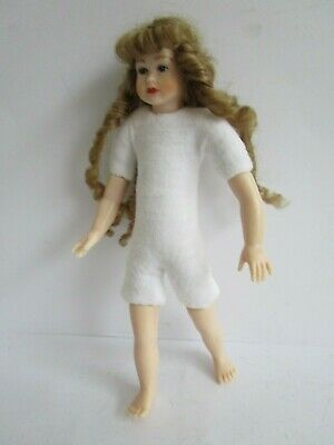 1:12 scale undressed dollhouse 4.75 inch teen girl with long curls and blue eyes