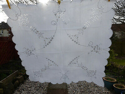 antique white work embroidered tablecloth, scalop edge.