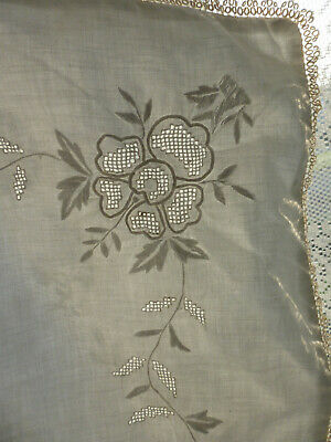 Pair of finely embroidered pillowcases edged with lace. White work embroidery