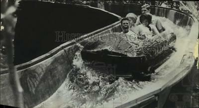 1964 Press Photo Six Flags Over Texas visitors on log flume ride in Arlington