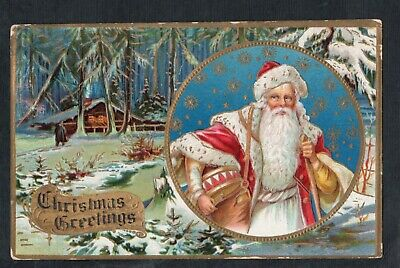 C394 postcard Christmas Santa Claus in gold circle and trim cabin in backgr