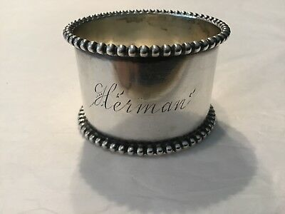 Antique beaded sterling napkin ring with the name HERMAN