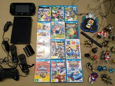 Nintendo Wii U Black with 11 games and 4 Controllers