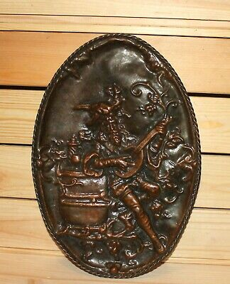 Antique hand made copper wall hanging plaque bard lute player