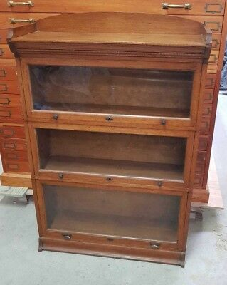 A Three Sectional Glazed Globe Wernicke Style Bookcase