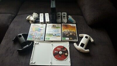 Nintendo Wii Black Console +4games and accessories no cords with this