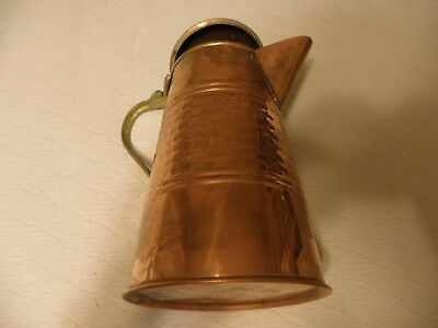 Vintage hammered copper water pitcher