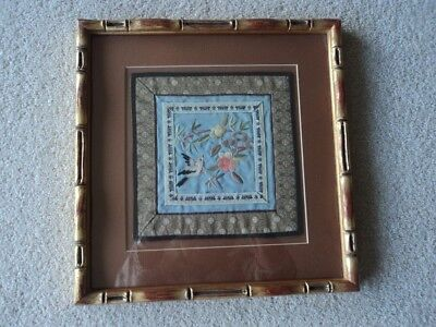 Embroidered Chinese silk in a bamboo style frame with glass