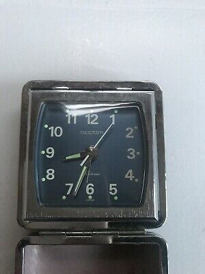 A Vintage Acctim Travel Alarm Clock In Leather Case
