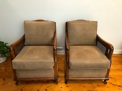 Pair of antique oak chairs with wicker sides
