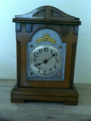 small wooden case wind up mantle clock